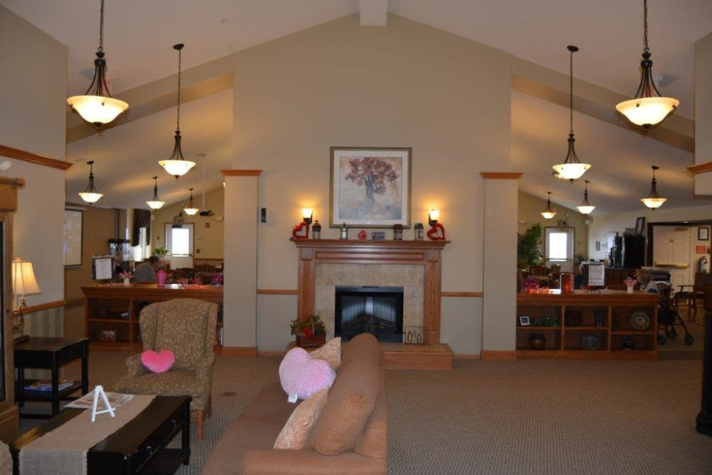 Main lobby features a fireplace and comfortable seating at Courtyard Estates at Hawthorne Crossing in Bondurant, Iowa