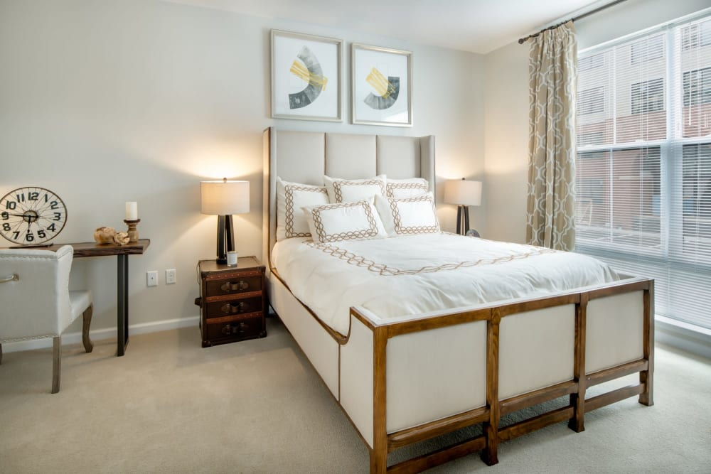 Bedroom with plush carpet at The Royal Belmont in Belmont, Massachusetts