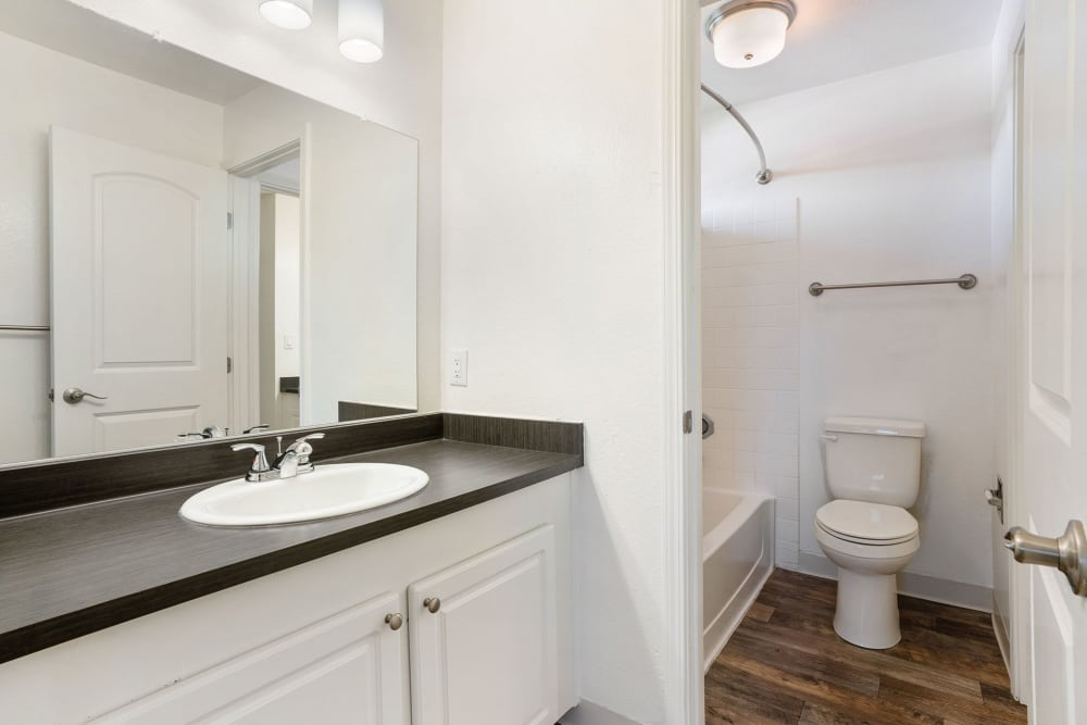 Bathroom with plenty of cabinet space at Ridgecrest Apartment Homes in Martinez, California