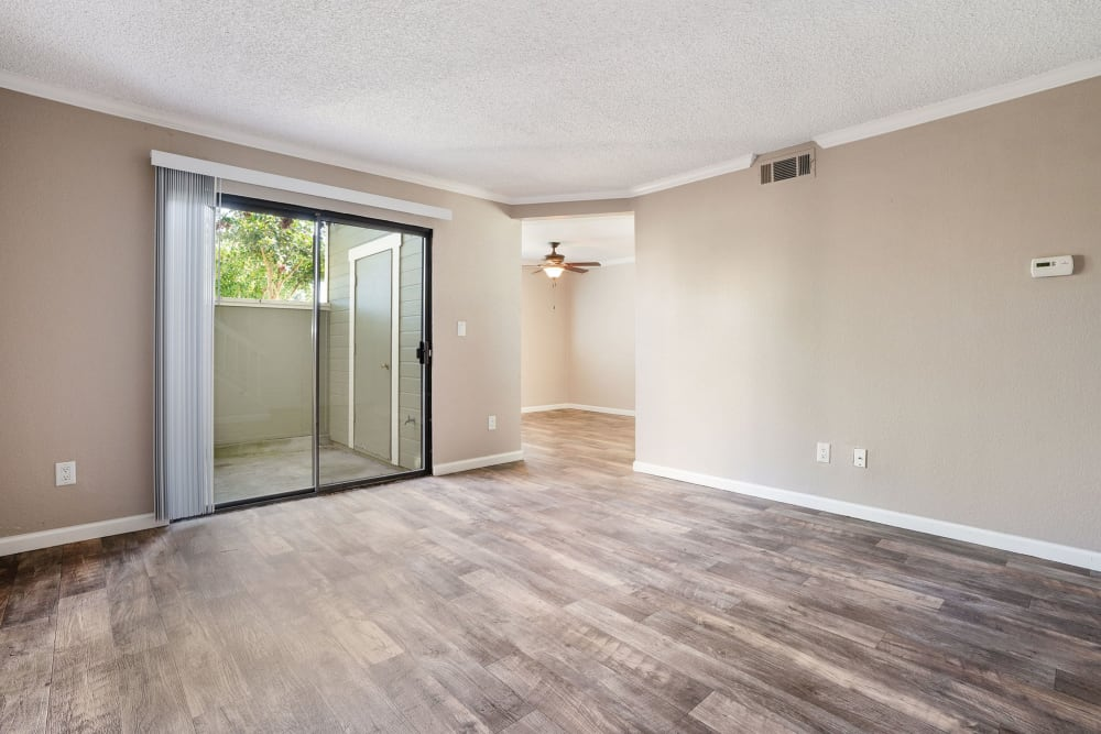 Living room with patio access at Ridgecrest Apartment Homes in Martinez, California