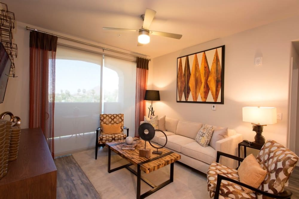 Spacious living room with a ceiling fan at Luxe Scottsdale Apartments in Scottsdale, Arizona