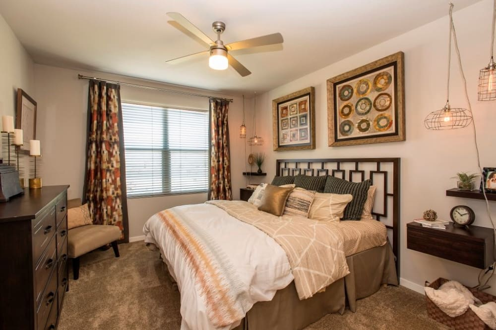 Bedroom with a ceiling fan at Luxe Scottsdale Apartments in Scottsdale, Arizona