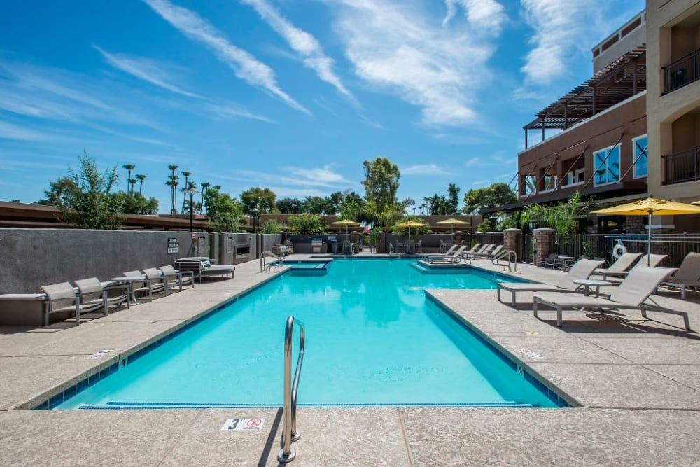 Luxurious swimming pool at Luxe Scottsdale Apartments in Scottsdale, Arizona