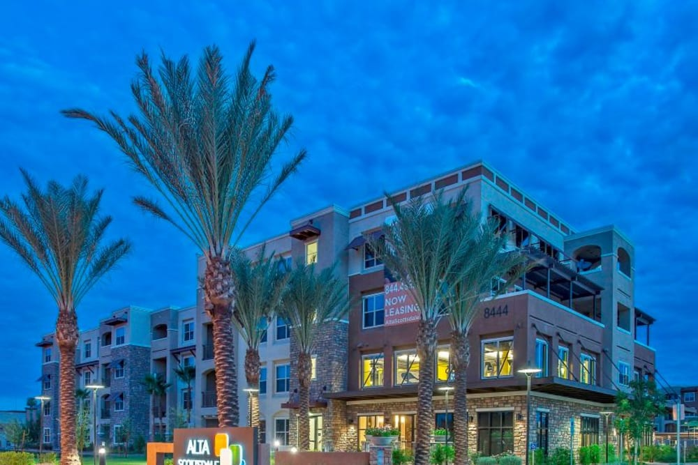 Exterior of Luxe Scottsdale Apartments at dusk in Scottsdale, Arizona