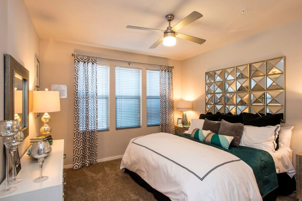 Bright master bedroom with plush carpet at Luxe Scottsdale Apartments in Scottsdale, Arizona