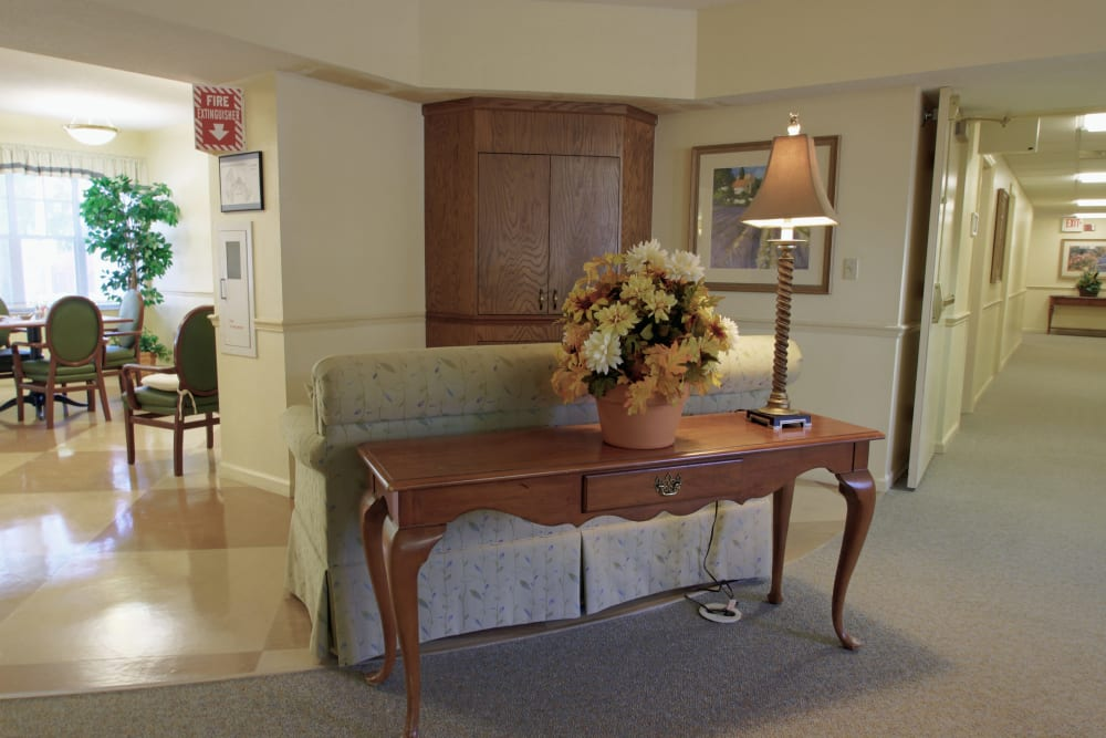 A hallway with nice furniture at Sunset Lake Village Senior Living in Venice, FL