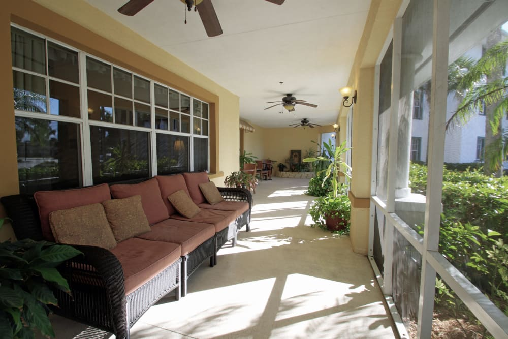 A porch with chairs at Sunset Lake Village Senior Living in Venice, FL