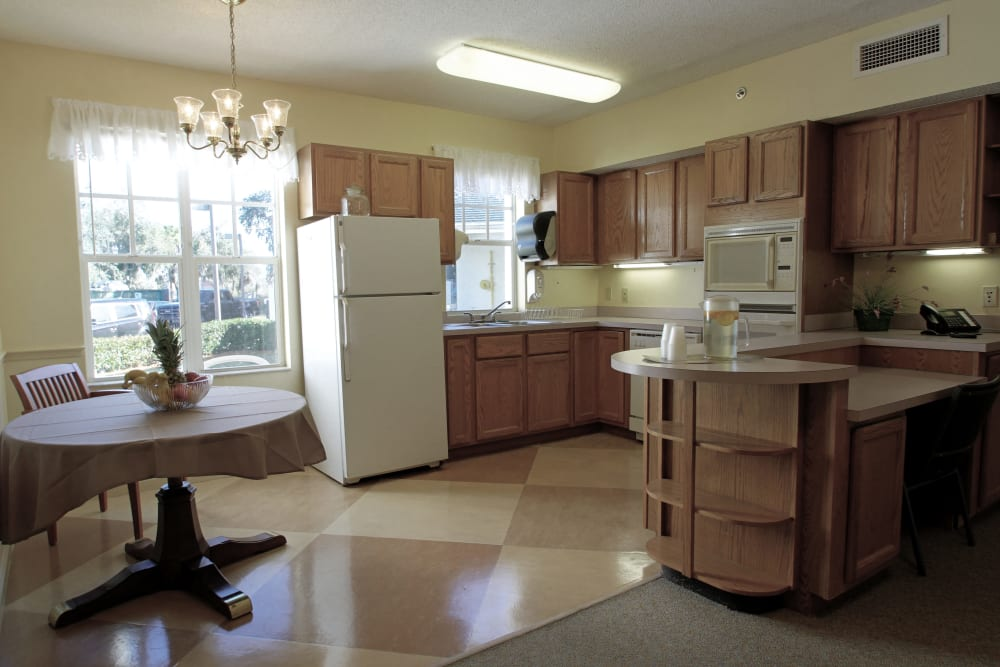 An apartment kitchen at Sunset Lake Village Senior Living in Venice, FL