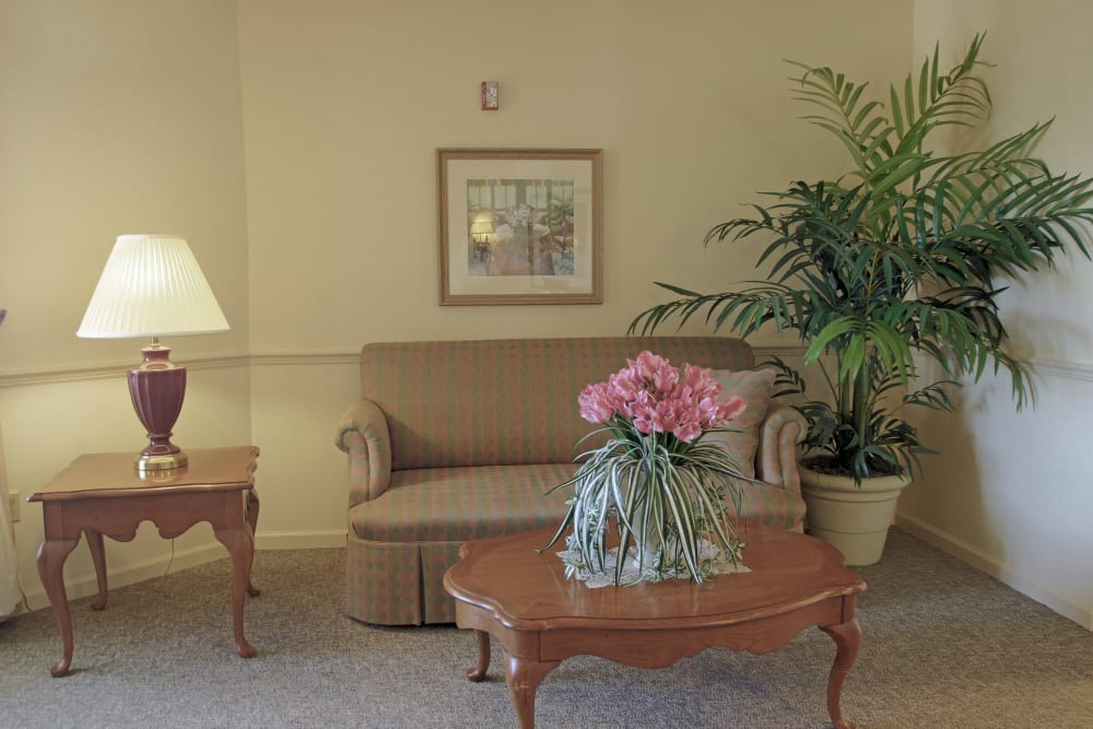 A couch with end table at Sunset Lake Village Senior Living in Venice, FL