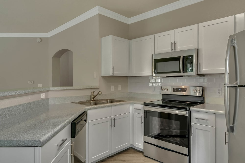 Modern kitchen in model apartment home at Palms at World Gateway in Orlando, Florida