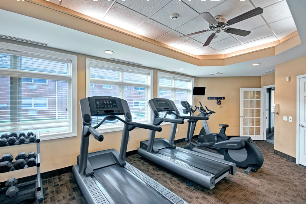 Fully equipped fitness center at New Orleans Park Apartments in Secane, Pennsylvania
