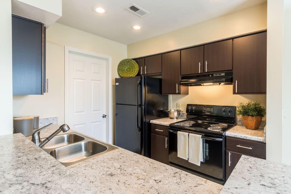Kitchen with granite counters at Sycamore Ridge in Dublin, Ohio