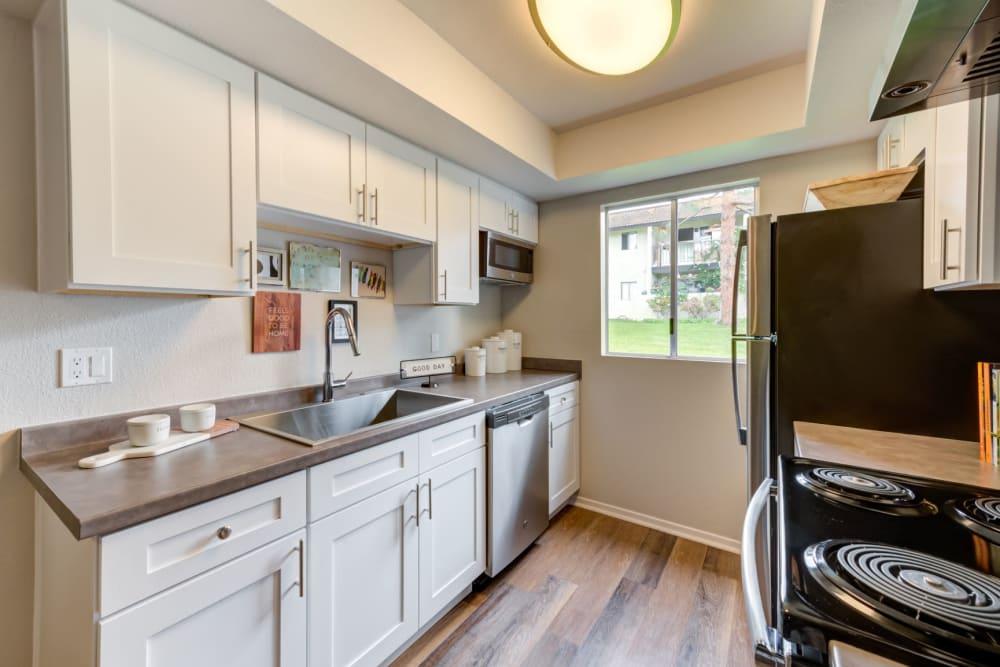 Luxury kitchens with hardwood floors at Sofi Ventura in Ventura, California