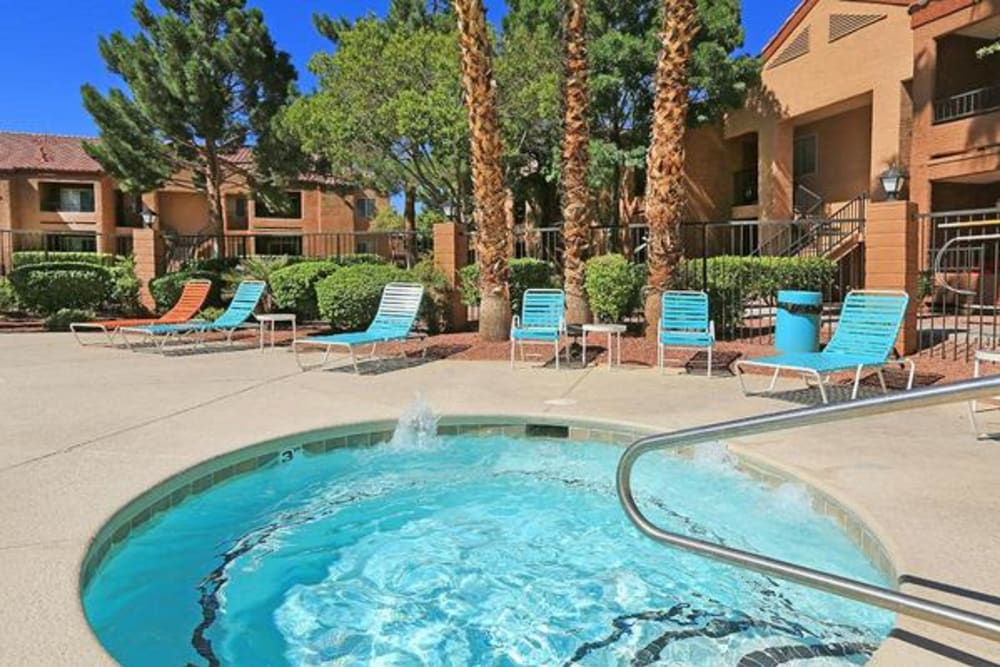 Spa with nearby lounge chairs at Alterra Apartments in Las Vegas, Nevada