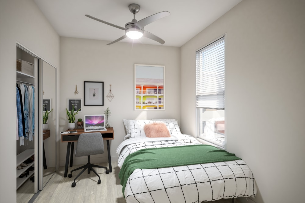 Bedroom with space for a study area at UNCOMMON Raleigh in Raleigh, North Carolina