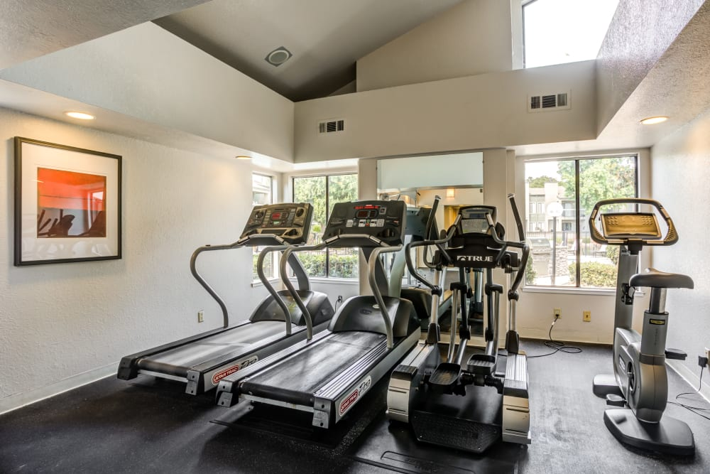 Fitness center equipment at Waterfield Square Apartment Homes in Stockton, California