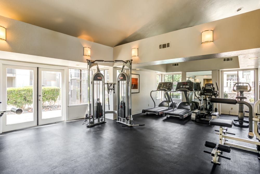 Fitness center with modern equipment and lots of natural light at Waterfield Square Apartment Homes in Stockton, California