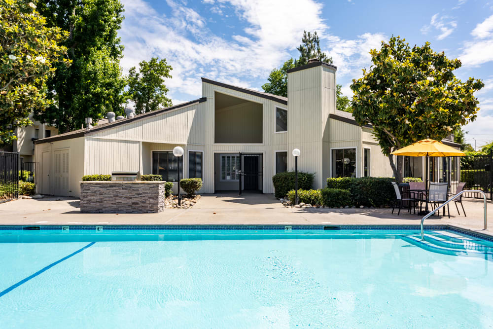 Clubhouse and pool at Waterfield Square Apartment Homes in Stockton, California
