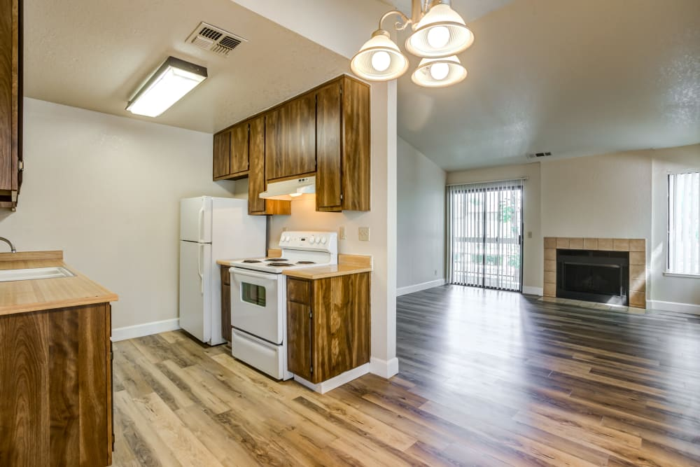 View of kitchen and spacious living room at Waterfield Square Apartment Homes in Stockton, California