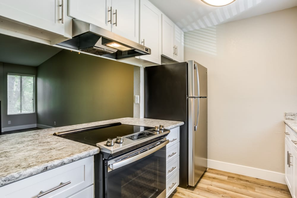 Kitchen with modern amenities and appliances at Waterfield Square Apartment Homes in Stockton, California