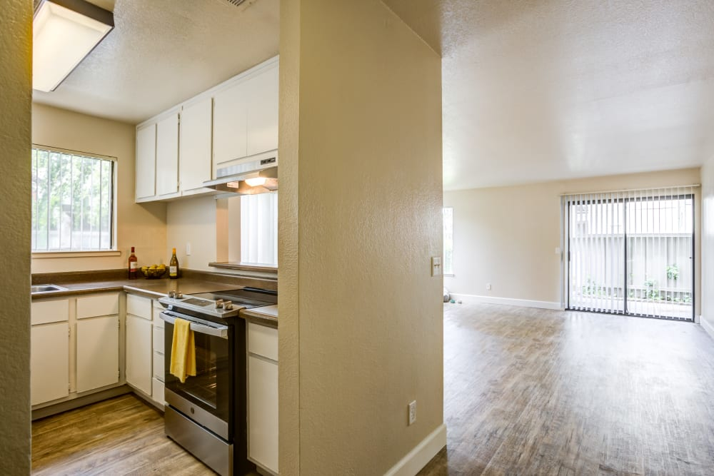 Kitchen and living room at Waterfield Square Apartment Homes in Stockton, California