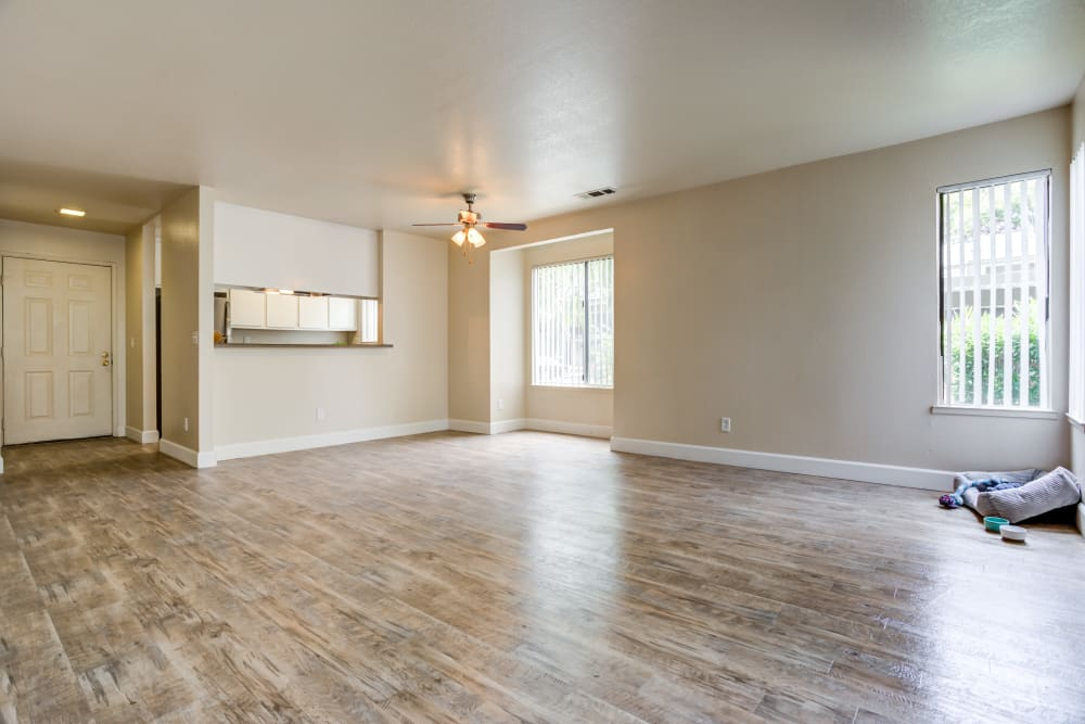 Living room with open format floor plan and abundant natural light at Waterfield Square Apartment Homes in Stockton, California