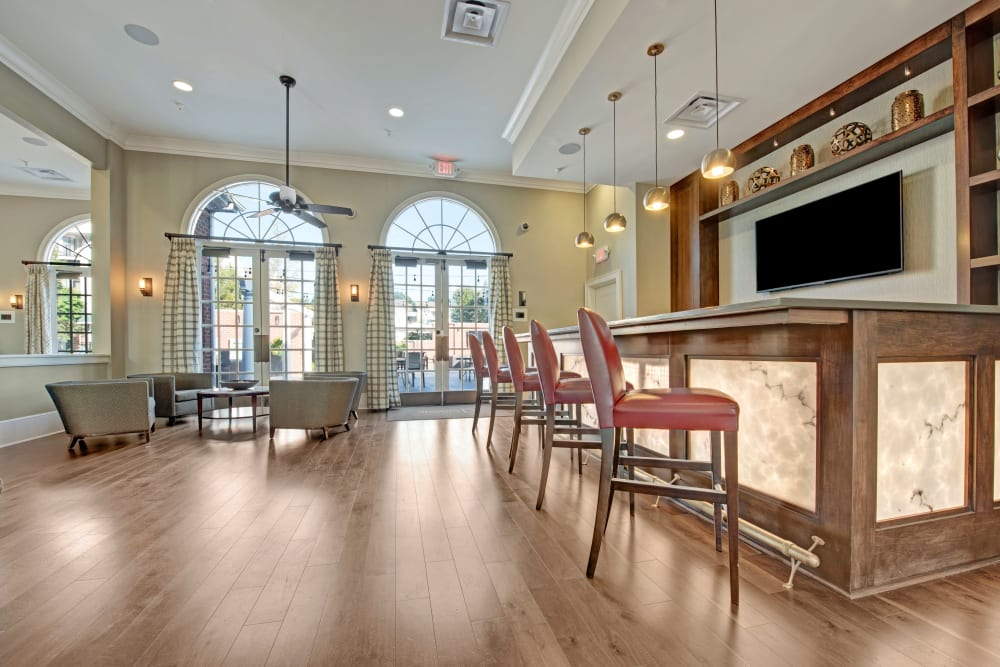 Barstools at stylish bar in clubhouse at Dulles Greene in Herndon, Virginia