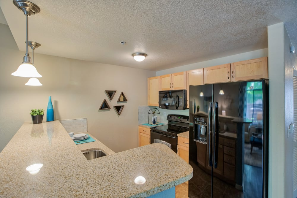 Kitchen at Downtown Belmar Apartments in Lakewood, CO