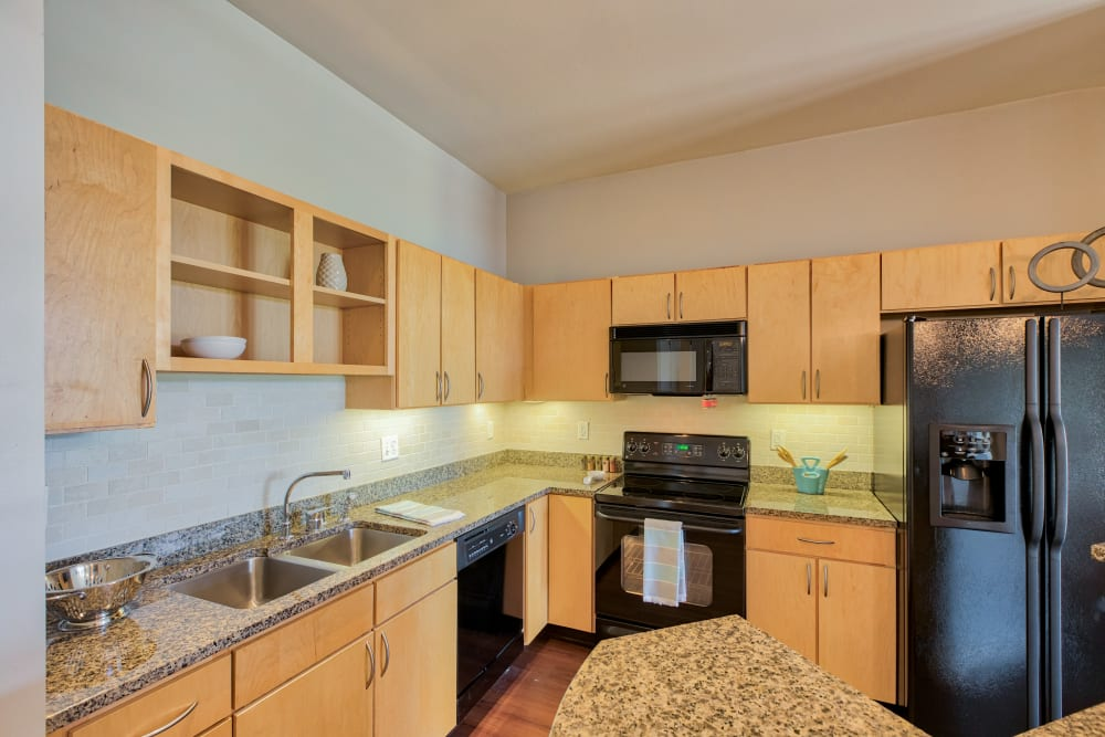Kitchen at Downtown Belmar Apartments in Lakewood, Colorado