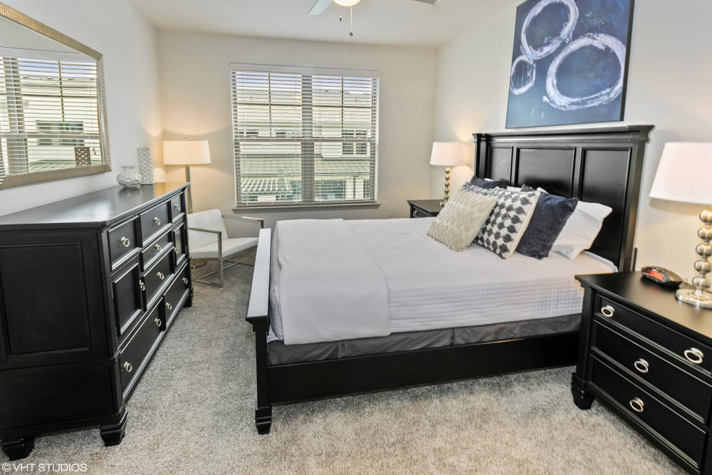 Apartment master bedroom at The Luxe at Cedar Hill in Cedar Hill, Texas
