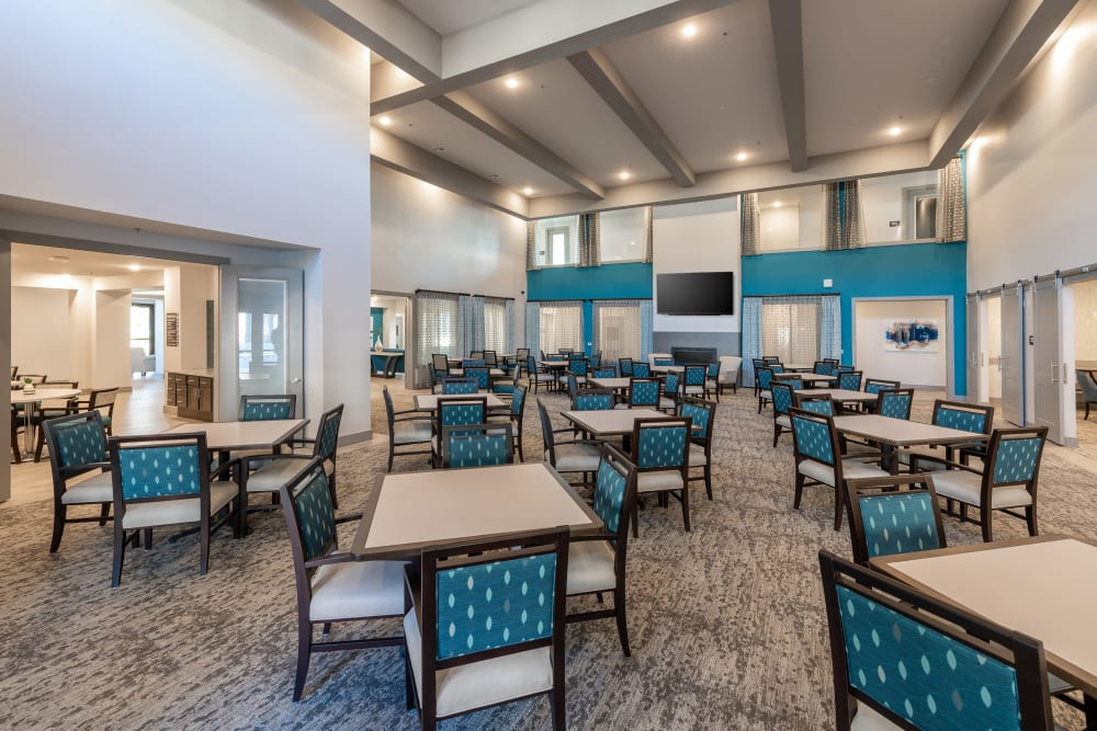 Giant dining hall with high ceilings and a large tv at The Luxe at Cedar Hill in Cedar Hill, Texas