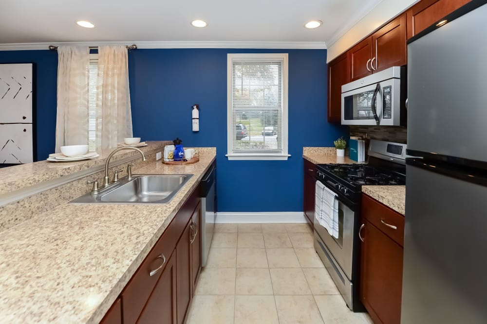 Kitchen with stainless appliances at The Villas at Bryn Mawr Apartment Homes