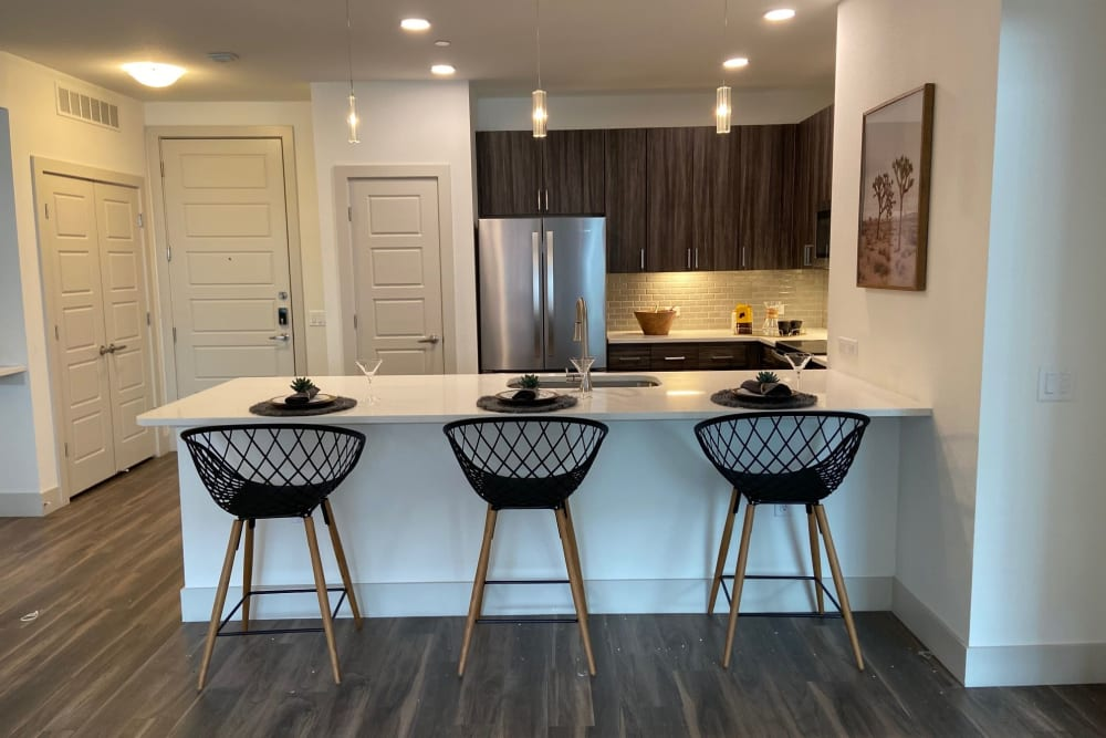 Kitchen with bar style seating at The District at Chandler in Chandler, Arizona