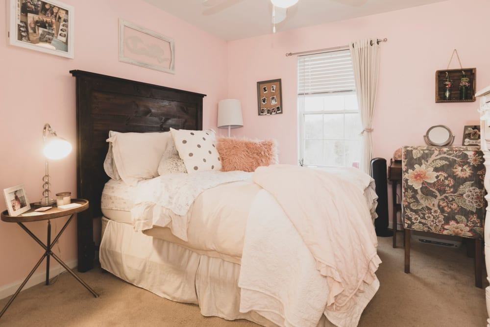 Master bedroom in model apartment home at Sunchase at Longwood in Farmville, Virginia