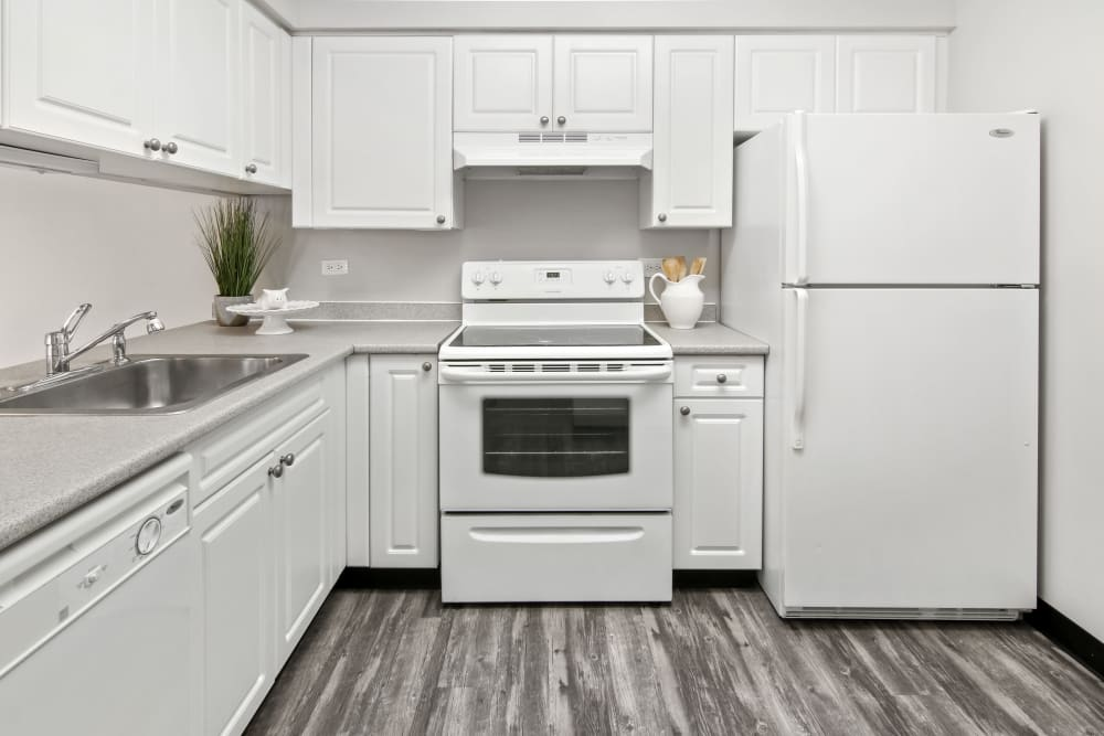 Kitchen with hardwood flooring at Lakeside Apartments in Wheaton, Illinois