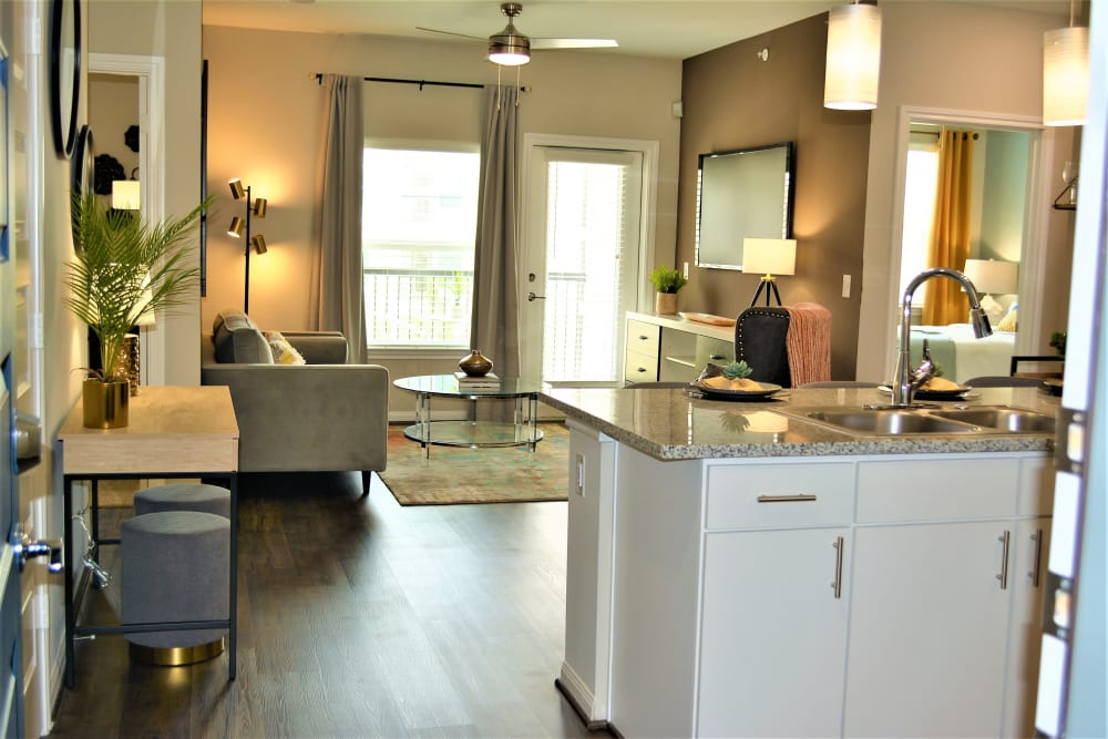 Open floor plan with living room and kitchen at The Abbey at Sonterra in San Antonio, Texas