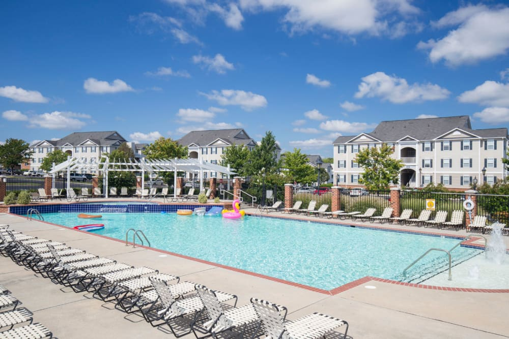 Lounge chairs by the pool at Sunchase at Longwood in Farmville, Virginia
