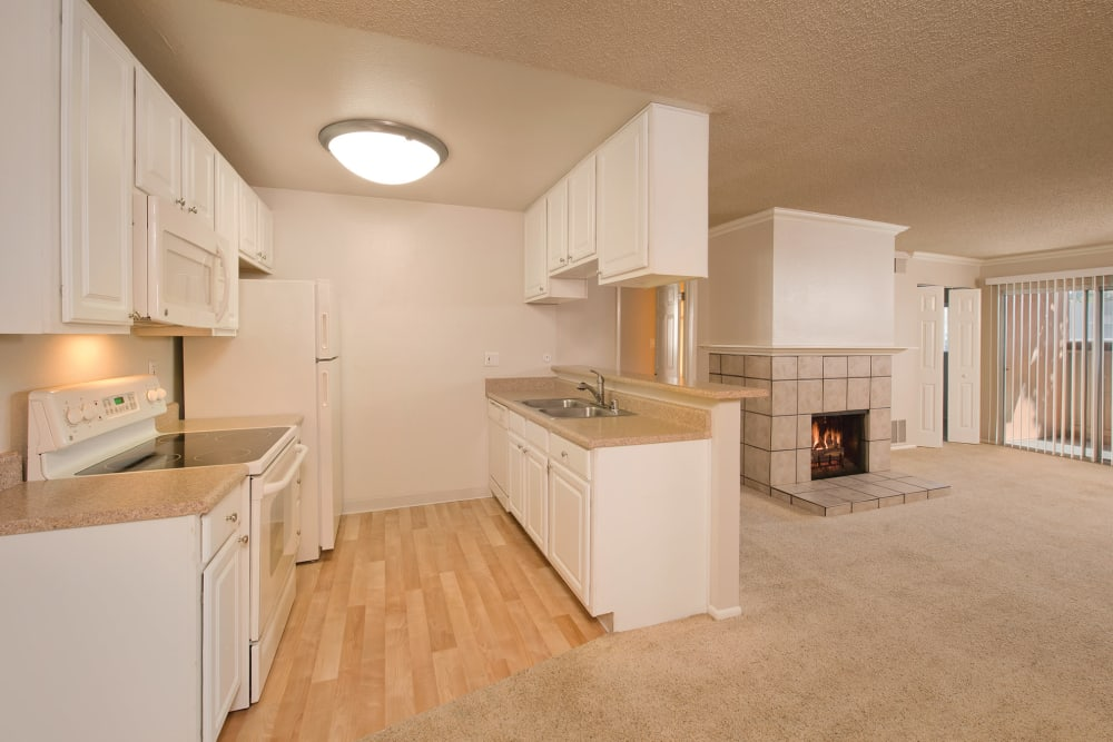 Kitchen with a pass-through window at La Valencia Apartment Homes in Campbell, California