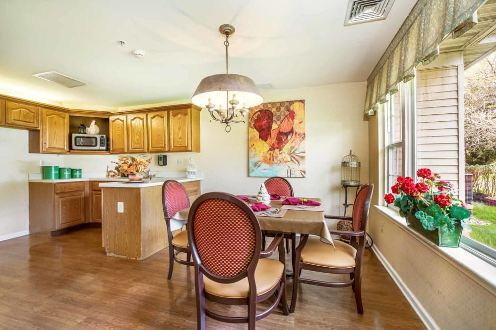 Kitchen and dining area at Floral Creek Alzheimer's Special Care Center in Yardley, Pennsylvania