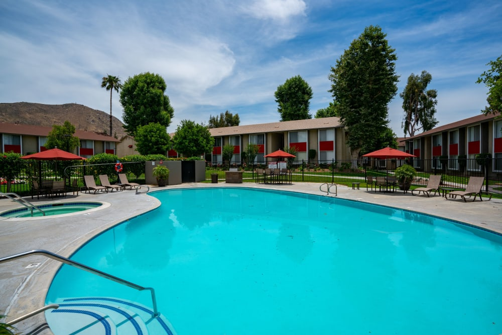 Sparkling swimming pool on a sunny day at The Heights at Grand Terrace in Grand Terrace, California