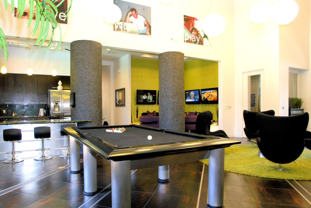 Clubhouse with a billiards table at Venu at Galleria Condominium Rentals in Roseville, California