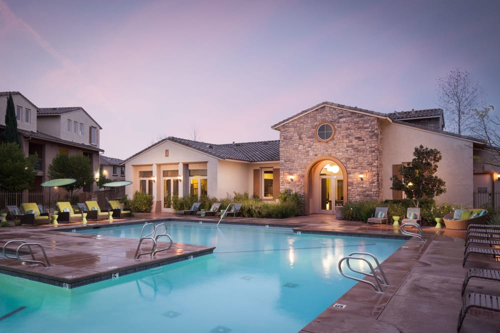 Resort-style swimming pool at night at Venu at Galleria Condominium Rentals in Roseville, California