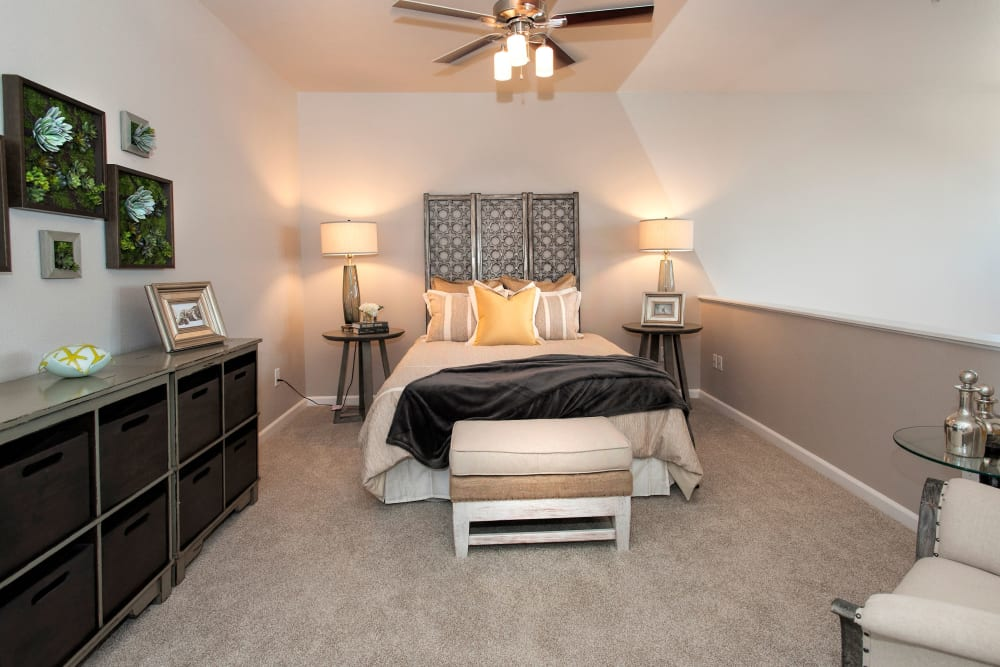Master bedroom with plush carpeting at Venu at Galleria Condominium Rentals in Roseville, California