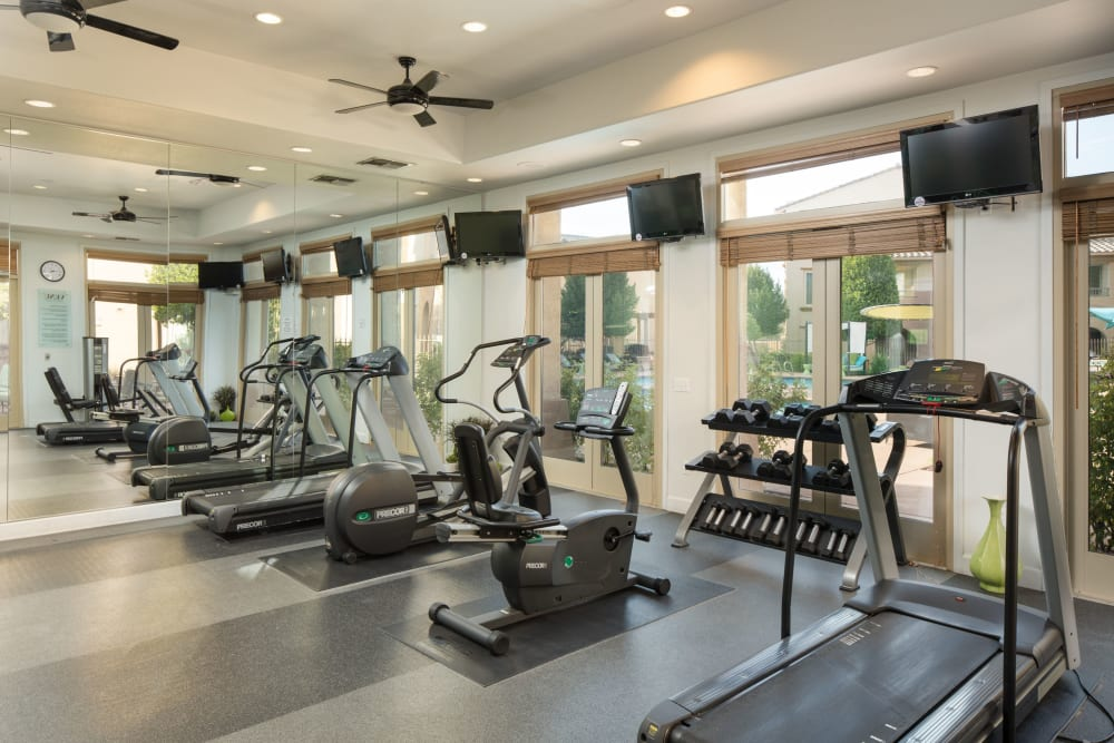 Fitness center with individual workout stations at Venu at Galleria Condominium Rentals in Roseville, California