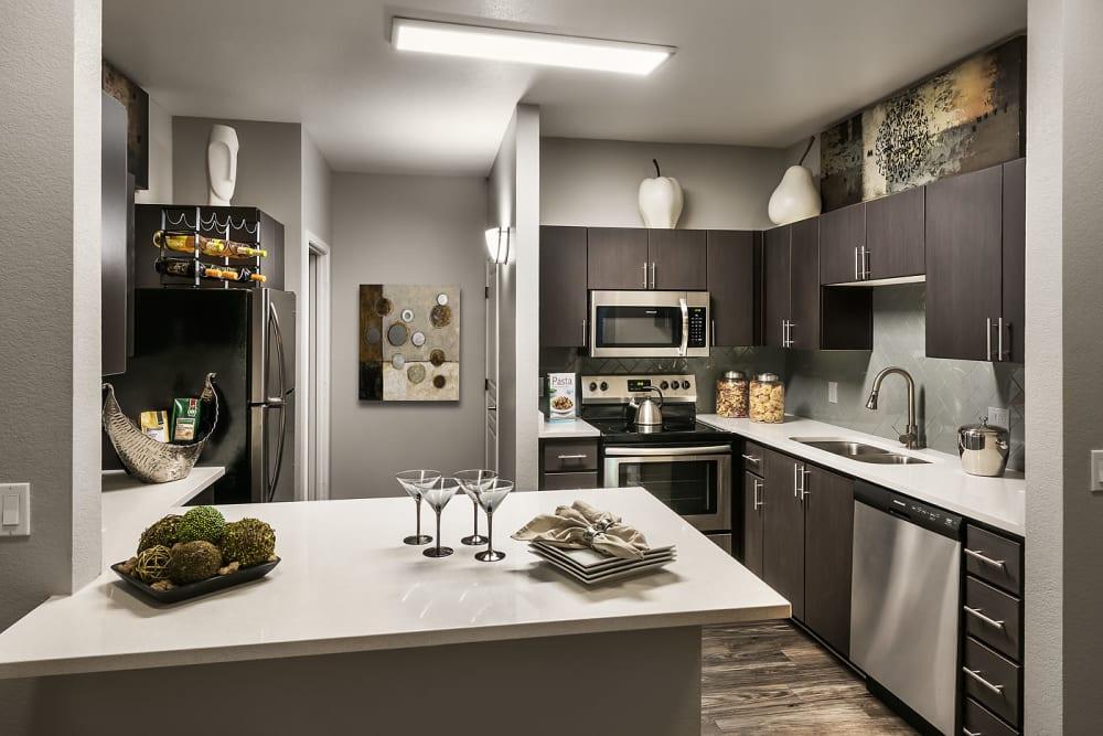 Gourmet kitchen in model home at Avenue 25 Apartments in Phoenix, Arizona