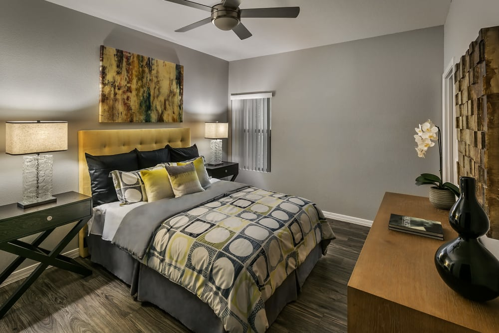 Master bedroom with a window at Avenue 25 Apartments in Phoenix, Arizona