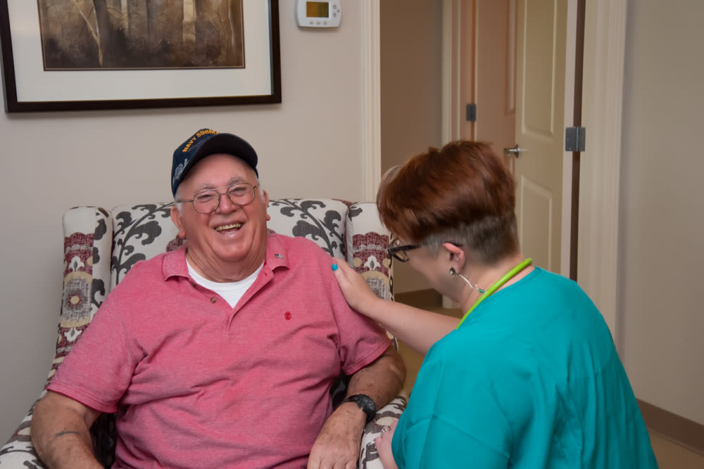 A nurse checking on a resident at Patriots Landing in DuPont, Washington.