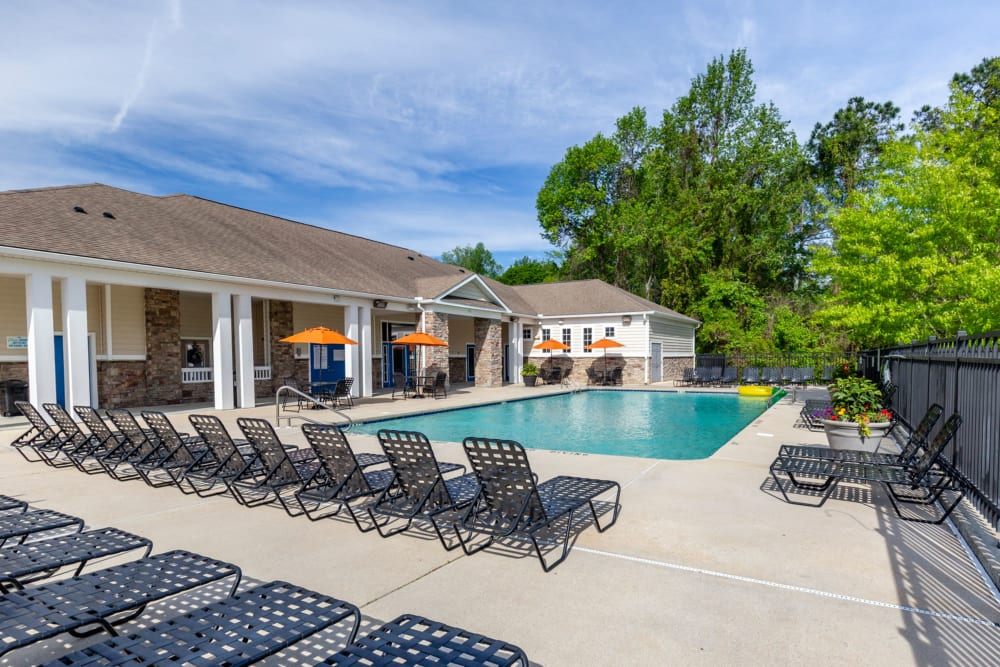 Pool lounge chairs at Sunchase Apartments in Greenville, North Carolina