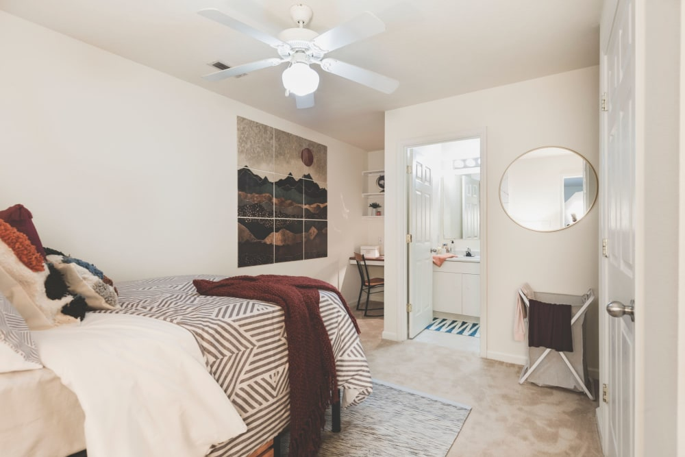 Bedroom with private bathroom at Sunchase Apartments in Greenville, North Carolina