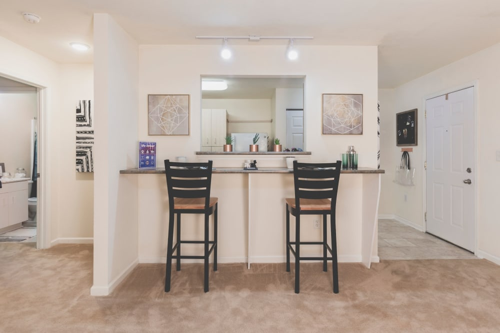 Bar stools by apartment kitchen at Sunchase Apartments in Greenville, North Carolina